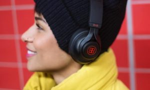 A woman wearing B&B Pure Headphones