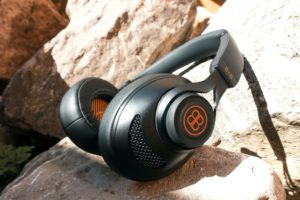 A set of B&B Pure Headphones sitting on a pile of rocks